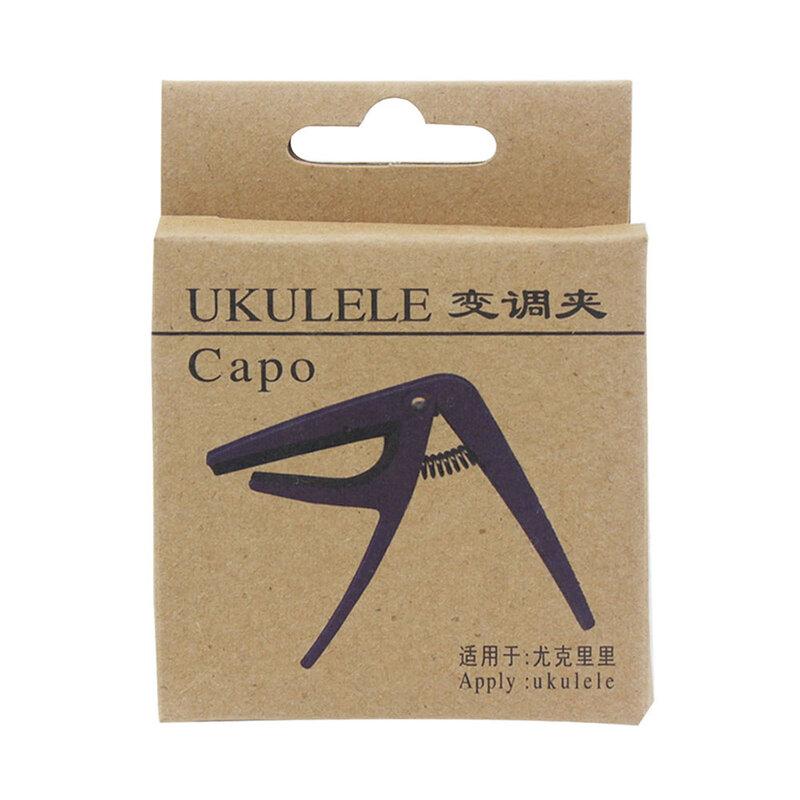 Professional สีดำ Ukulele Capo จูนเนอร์เครื่องดนตรีอะคูสติก4สตริงกีตาร์ฮาวายปรับ Clamp